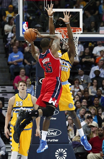 Mar 23, 2014; Denver, CO, USA; Denver Nuggets small forward Kenneth Faried (35) blocks the shot by Washington Wizards power forward Trevor Booker (35) in the third quarter at the Pepsi Center. The Nuggets won 105-102. Mandatory Credit: Isaiah J. Downing-USA TODAY Sports