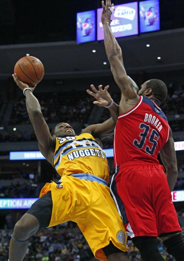 Mar 23, 2014; Denver, CO, USA; Washington Wizards power forward Trevor Booker (35) blocks the shot by Denver Nuggets small forward Kenneth Faried (35) in the third quarter at the Pepsi Center. The Nuggets won 105-102. Mandatory Credit: Isaiah J. Downing-USA TODAY Sports