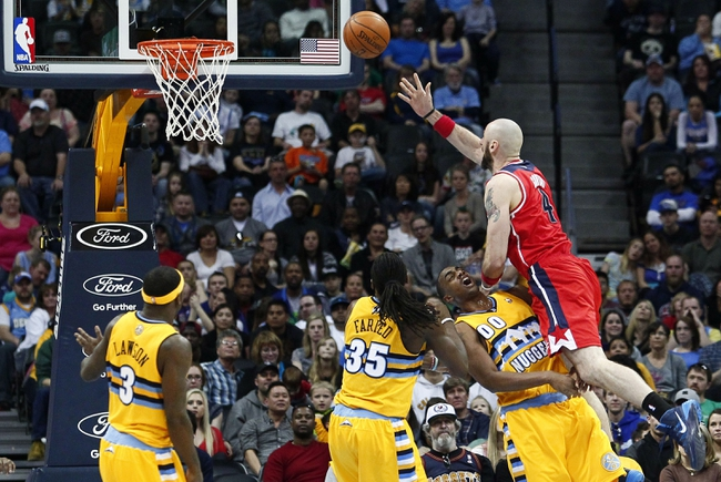 Mar 23, 2014; Denver, CO, USA; Washington Wizards center Marcin Gortat (4) shoots the ball over Denver Nuggets power forward Darrell Arthur (00) in the fourth quarter at the Pepsi Center. The Nuggets won 105-102. Mandatory Credit: Isaiah J. Downing-USA TODAY Sports