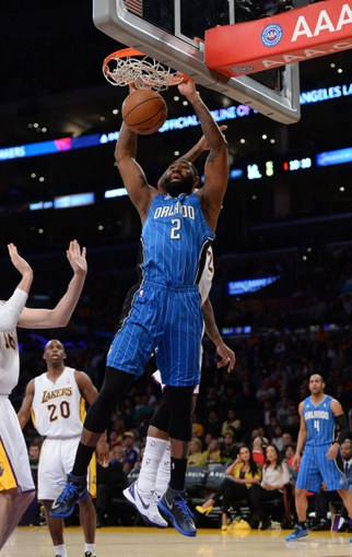 Mar 23, 2014; Los Angeles, CA, USA; Orlando Magic forward Kyle O'Quinn (2) dunks the ball against the Los Angeles Lakers at Staples Center. Mandatory Credit: Kirby Lee-USA TODAY Sports