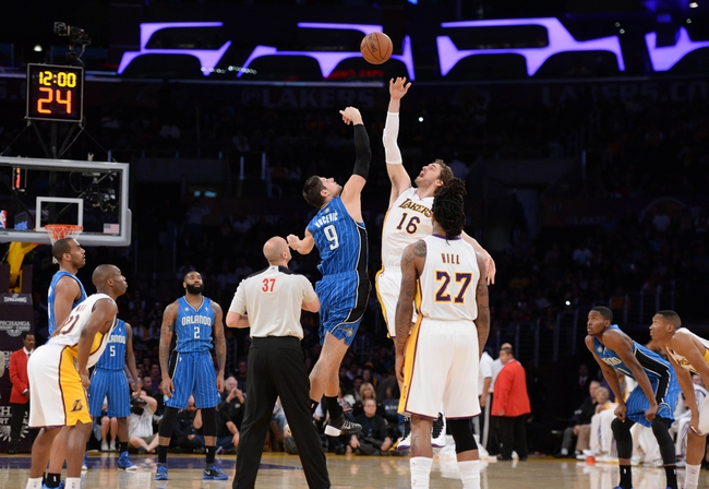 Mar 23, 2014; Los Angeles, CA, USA; Orlando Magic forward Nikola Vucevic (9) battles for the tip-off with Los Angeles Lakers forward Pau Gasol (16) in the first quarter at Staples Center. Mandatory Credit: Kirby Lee-USA TODAY Sports