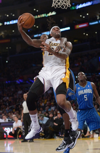 Mar 23, 2014; Los Angeles, CA, USA; Los Angeles Lakers forward Jordan Hill (27) is fouled by Orlando Magic center Dewayne Dedmon (3) at Staples Center. The Lakers won 103-94. Mandatory Credit: Kirby Lee-USA TODAY Sports