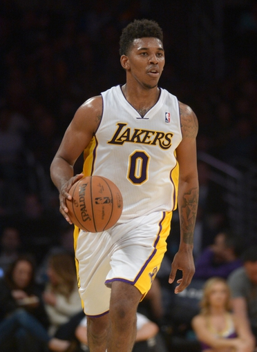 Mar 23, 2014; Los Angeles, CA, USA; Los Angeles Lakers guard Nick Young (0) dribbles the ball against the Orlando Magic at Staples Center. The Lakers won 103-94. Mandatory Credit: Kirby Lee-USA TODAY Sports