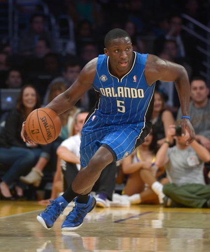 Mar 23, 2014; Los Angeles, CA, USA; Orlando Magic guard Victor Oladipo (5) dribbles the ball against the Los Angeles Lakers at Staples Center. Mandatory Credit: Kirby Lee-USA TODAY Sports