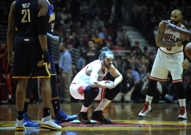 Mar 24, 2014; Chicago, IL, USA;  Chicago Bulls center Joakim Noah (13) before the start of the game against the Indiana Pacers at the United Center. Mandatory Credit: David Banks-USA TODAY Sports
