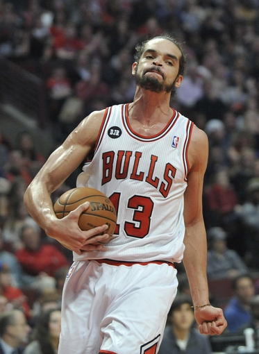 Mar 24, 2014; Chicago, IL, USA; Chicago Bulls center Joakim Noah (13) reacts after causing an Indiana Pacers turnover during the first half at the United Center. Mandatory Credit: David Banks-USA TODAY Sports