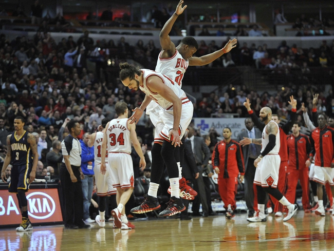 Mar 24, 2014; Chicago, IL, USA; Chicago Bulls center Joakim Noah (L) and  guard Jimmy Butler (21) react after the Bulls scored against the Indiana Pacers during the second half at the United Center. the Chicago Bulls defeated the Indiana Pacers 89-77. Mandatory Credit: David Banks-USA TODAY Sports