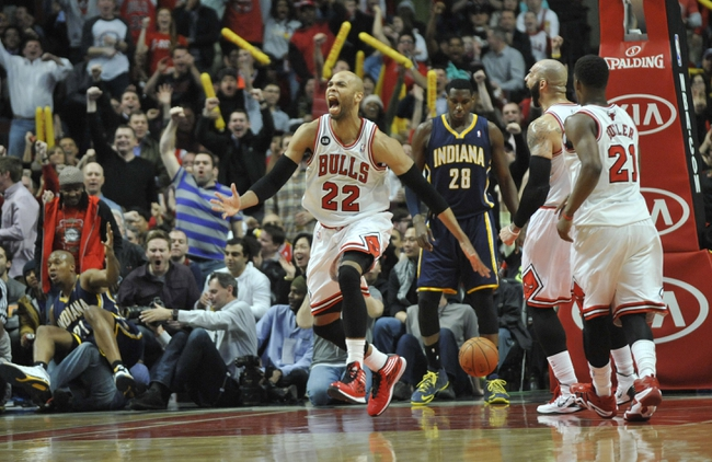 Mar 24, 2014; Chicago, IL, USA; Chicago Bulls forward Taj Gibson (22) reacts after scoring against the Indiana Pacers during the second half at the United Center. the Chicago Bulls defeated the Indiana Pacers 89-77. Mandatory Credit: David Banks-USA TODAY Sports