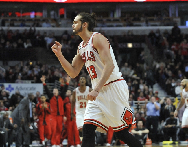 Mar 24, 2014; Chicago, IL, USA; Chicago Bulls center Joakim Noah (13) reacts after the Bulls scored against the Indiana Pacers during the second half at the United Center. the Chicago Bulls defeated the Indiana Pacers 89-77. Mandatory Credit: David Banks-USA TODAY Sports