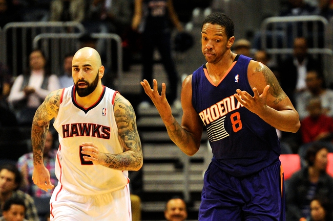 Mar 24, 2014; Atlanta, GA, USA; Phoenix Suns forward Channing Frye (8) reacts in front of Atlanta Hawks center Pero Antic (6) after hitting a three point shot during the second half at Philips Arena. The Suns defeated the Hawks 102-95. Mandatory Credit: Dale Zanine-USA TODAY Sports