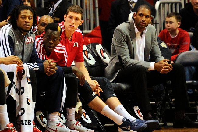 Mar 24, 2014; Atlanta, GA, USA; Injured Atlanta Hawks center Al Horford (15) (gray sports coat) sits on the bench with team mates during the game against the Phoenix Suns during the second half at Philips Arena. The Suns defeated the Hawks 102-95. Mandatory Credit: Dale Zanine-USA TODAY Sports