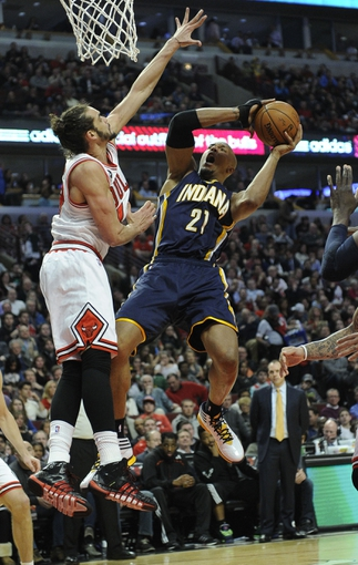 Mar 24, 2014; Chicago, IL, USA;  Indiana Pacers forward David West (21) is defended by Chicago Bulls center Joakim Noah (13) during the second half at the United Center. the Chicago Bulls defeated the Indiana Pacers 89-77. Mandatory Credit: David Banks-USA TODAY Sports