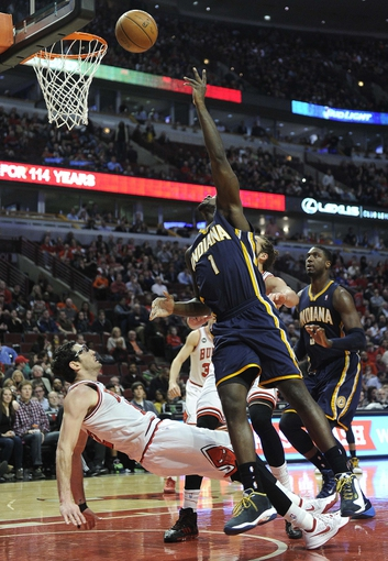 Mar 24, 2014; Chicago, IL, USA;  Indiana Pacers guard Lance Stephenson (1) is defended by Chicago Bulls guard Kirk Hinrich (12) during the second half at the United Center. the Chicago Bulls defeated the Indiana Pacers 89-77. Mandatory Credit: David Banks-USA TODAY Sports