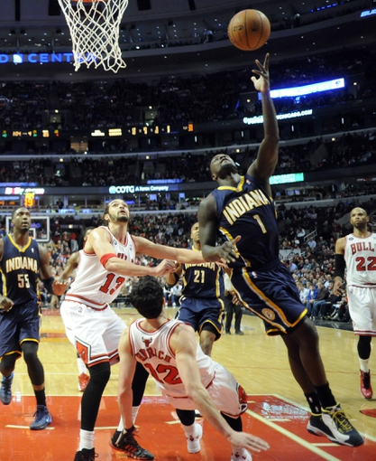 Mar 24, 2014; Chicago, IL, USA;  Indiana Pacers guard Lance Stephenson (1) is defended by Chicago Bulls guard Kirk Hinrich (12) and center Joakim Noah (13) during the second half at the United Center. the Chicago Bulls defeated the Indiana Pacers 89-77. Mandatory Credit: David Banks-USA TODAY Sports