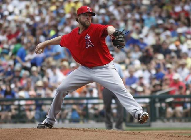 Mar 25, 2014; Mesa, AZ, USA; Los Angeles Angels pitcher Brandon Lyon (99) throws in the first inning against the Chicago Cubs at HoHoKam Park. Mandatory Credit: Rick Scuteri-USA TODAY Sports