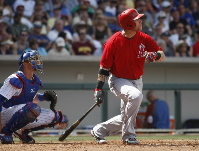 Mar 25, 2014; Mesa, AZ, USA; Los Angeles Angels left fielder Josh Hamilton (32) hits a double in the third inning against the Chicago Cubs at HoHoKam Park. Mandatory Credit: Rick Scuteri-USA TODAY Sports