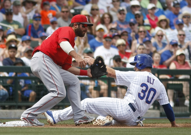 Mar 25, 2014; Mesa, AZ, USA; Chicago Cubs first baseman Mike Olt (30) slides into third base safely in front of Los Angeles Angels third baseman David Freese (6) in the third inning at HoHoKam Park. Mandatory Credit: Rick Scuteri-USA TODAY Sports