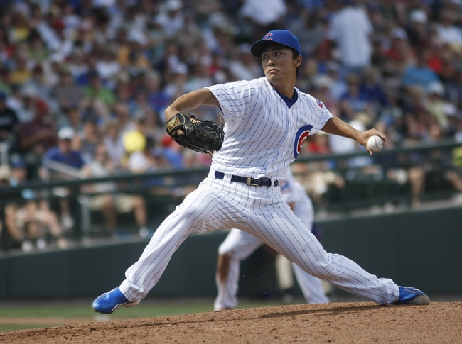 Mar 25, 2014; Mesa, AZ, USA; Chicago Cubs pitcher Tsuyoshi Wada (67) throws in the third inning against the Los Angeles Angels at HoHoKam Park. Mandatory Credit: Rick Scuteri-USA TODAY Sports