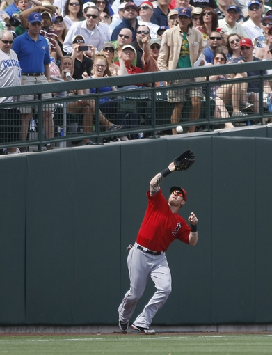 Mar 25, 2014; Mesa, AZ, USA; Los Angeles Angels left fielder Josh Hamilton (32) makes the catch in the third inning against the Chicago Cubs at HoHoKam Park. Mandatory Credit: Rick Scuteri-USA TODAY Sports