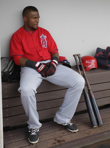 Mar 25, 2014; Mesa, AZ, USA; Los Angeles Angels shortstop Erick Aybar (2) sits in the dugout between innings against the Chicago Cubs at HoHoKam Park. Mandatory Credit: Rick Scuteri-USA TODAY Sports
