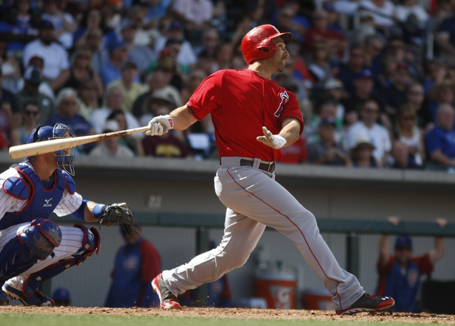 Mar 25, 2014; Mesa, AZ, USA; Los Angeles Angels left fielder Raul Ibanez (28) hits a solo homerun in the fourth inning against the Chicago Cubs at HoHoKam Park. Mandatory Credit: Rick Scuteri-USA TODAY Sports