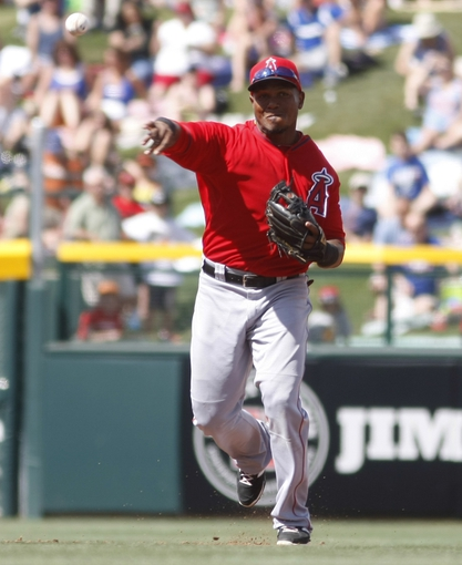 Mar 25, 2014; Mesa, AZ, USA; Los Angeles Angels shortstop Erick Aybar (2) makes the throw for the out against the Chicago Cubs in third inning at HoHoKam Park. Mandatory Credit: Rick Scuteri-USA TODAY Sports