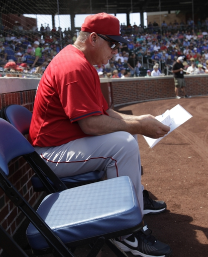 Mar 25, 2014; Mesa, AZ, USA; Los Angeles Angels manager Mike Scioscia (14) before a game against the Chicago Cubs at HoHoKam Park. Mandatory Credit: Rick Scuteri-USA TODAY Sports