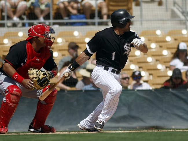 Mar 26, 2014; Phoenix, AZ, USA; Chicago White Sox left fielder Adam Eaton (1) singles in the first inning against the Cincinnati Reds at Camelback Ranch. Mandatory Credit: Rick Scuteri-USA TODAY Sports