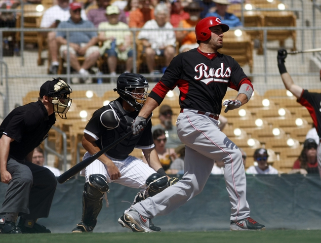 Mar 26, 2014; Phoenix, AZ, USA; Cincinnati Reds first baseman Joey Votto (19) at bat against the Chicago White Sox in the first inning at Camelback Ranch. Mandatory Credit: Rick Scuteri-USA TODAY Sports