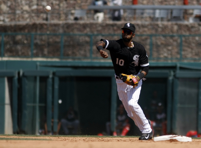 Mar 26, 2014; Phoenix, AZ, USA; Chicago White Sox shortstop Alexei Ramirez (10) makes the play for the out against the Cincinnati Reds in the fourth inning at Camelback Ranch. Mandatory Credit: Rick Scuteri-USA TODAY Sports