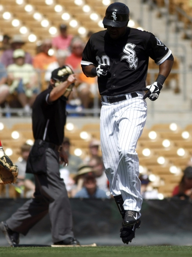 Mar 26, 2014; Phoenix, AZ, USA; Chicago White Sox center fielder Alejandro De Aza (30) reacts after getting hit by a pitch in the second inning against the Cincinnati Reds at Camelback Ranch. Mandatory Credit: Rick Scuteri-USA TODAY Sports