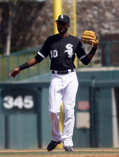 Mar 26, 2014; Phoenix, AZ, USA; Chicago White Sox shortstop Alexei Ramirez (10) reacts to a foul ball against the Cincinnati Reds at Camelback Ranch. Mandatory Credit: Rick Scuteri-USA TODAY Sports