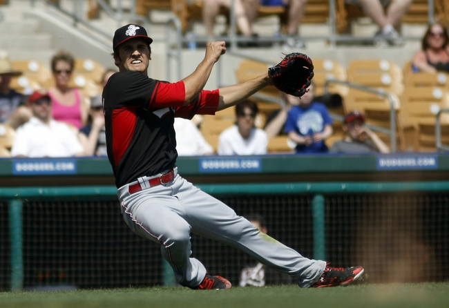 Mar 26, 2014; Phoenix, AZ, USA; Cincinnati Reds starting pitcher Brett Marshall (41) makes a throw to first base against the Chicago White Sox in the third inning at Camelback Ranch. Mandatory Credit: Rick Scuteri-USA TODAY Sports