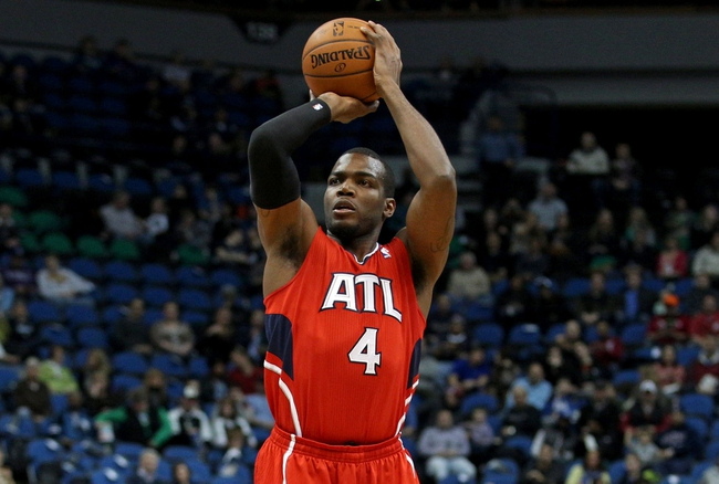 Mar 26, 2014; Minneapolis, MN, USA; Atlanta Hawks forward Paul Millsap (4) shoots during the first quarter against the Minnesota Timberwolves at Target Center. Mandatory Credit: Brace Hemmelgarn-USA TODAY Sports