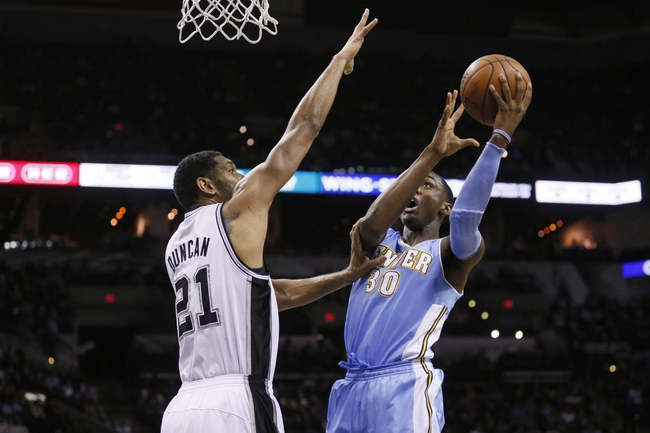 Mar 26, 2014; San Antonio, TX, USA; Denver Nuggets forward Quincy Miller (30) shoots as San Antonio Spurs forward Tim Duncan (21) defends during the first half at AT&T Center. Mandatory Credit: Soobum Im-USA TODAY Sports