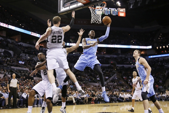 Mar 26, 2014; San Antonio, TX, USA; Denver Nuggets forward Quincy Miller (30) shoots the ball against the San Antonio Spurs during the first half at AT&T Center. Mandatory Credit: Soobum Im-USA TODAY Sports