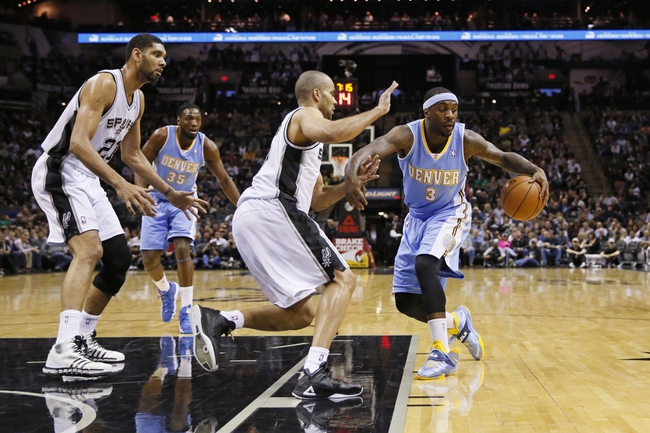 Mar 26, 2014; San Antonio, TX, USA; Denver Nuggets guard Ty Lawson (3) drives the ball against San Antonio Spurs guard Tony Parker (left) during the first half at AT&T Center. Mandatory Credit: Soobum Im-USA TODAY Sports