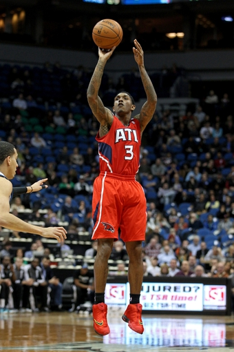 Mar 26, 2014; Minneapolis, MN, USA; Atlanta Hawks guard Louis Williams (3) shoots during the second quarter against the Minnesota Timberwolves at Target Center. Mandatory Credit: Brace Hemmelgarn-USA TODAY Sports