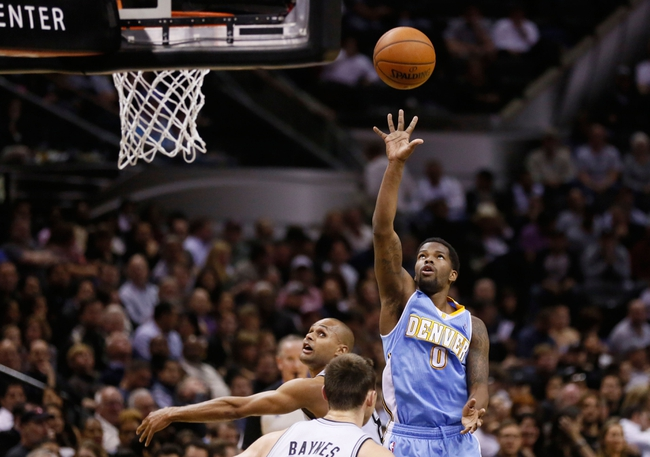Mar 26, 2014; San Antonio, TX, USA; Denver Nuggets guard Aaron Brooks (0) shoots the ball against the San Antonio Spurs during the first half at AT&T Center. Mandatory Credit: Soobum Im-USA TODAY Sports