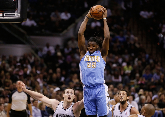 Mar 26, 2014; San Antonio, TX, USA; Denver Nuggets forward Kenneth Faried (35) pulls down a rebound during the first half against the San Antonio Spurs at AT&T Center. Mandatory Credit: Soobum Im-USA TODAY Sports