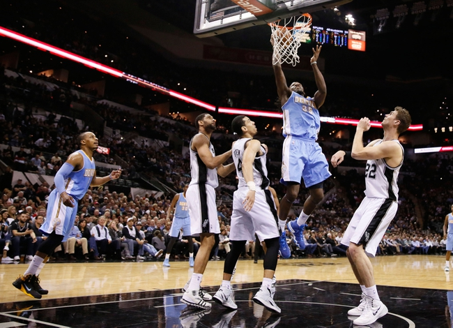 Mar 26, 2014; San Antonio, TX, USA; Denver Nuggets forward Kenneth Faried (35) shoots the ball against the San Antonio Spurs during the first half at AT&T Center. Mandatory Credit: Soobum Im-USA TODAY Sports