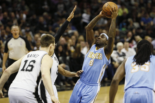 Mar 26, 2014; San Antonio, TX, USA; Denver Nuggets guard Ty Lawson (3) shoots as San Antonio Spurs guard Patrick Mills (left) defends during the first half at AT&T Center. Mandatory Credit: Soobum Im-USA TODAY Sports