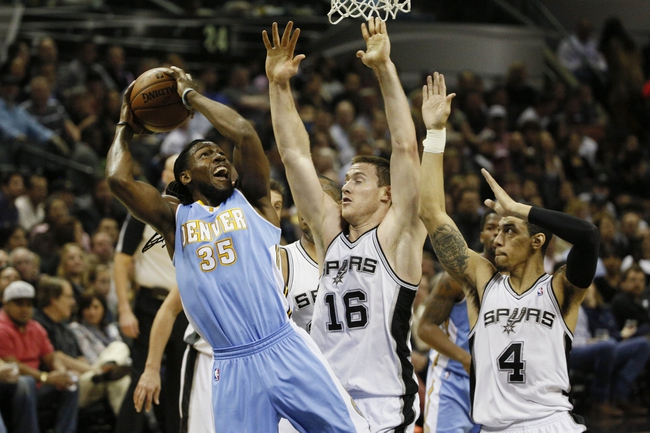 Mar 26, 2014; San Antonio, TX, USA; Denver Nuggets forward Kenneth Faried (35) shoots as San Antonio Spurs forward Aron Baynes (16) and guard Danny Green (4) defend during the first half at AT&T Center. Mandatory Credit: Soobum Im-USA TODAY Sports