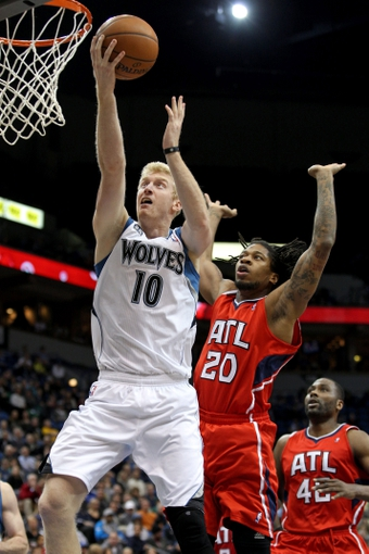 Mar 26, 2014; Minneapolis, MN, USA; Minnesota Timberwolves forward Chase Budinger (10) shoots over Atlanta Hawks forward Cartier Martin (20) during the fourth quarter at Target Center. The Timberwolves defeated the Hawks 107-83. Mandatory Credit: Brace Hemmelgarn-USA TODAY Sports