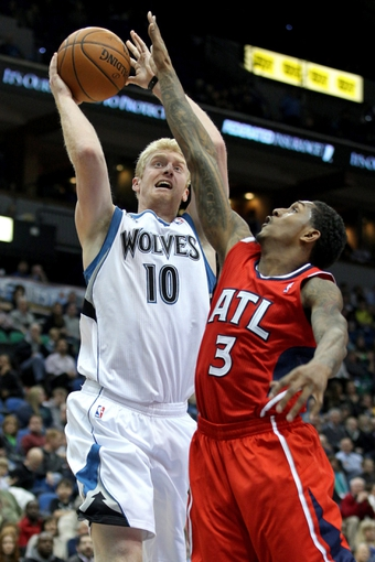 Mar 26, 2014; Minneapolis, MN, USA; Minnesota Timberwolves forward Chase Budinger (10) shoots over Atlanta Hawks guard Louis Williams (3) during the fourth quarter at Target Center. The Timberwolves defeated the Hawks 107-83. Mandatory Credit: Brace Hemmelgarn-USA TODAY Sports