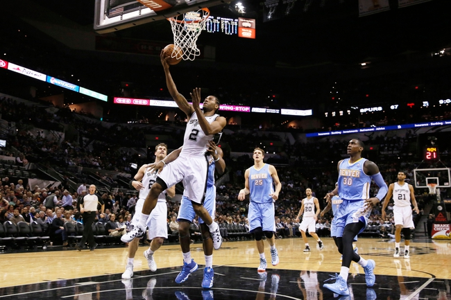 Mar 26, 2014; San Antonio, TX, USA; San Antonio Spurs forward Kawhi Leonard (2) shoots the ball against the Denver Nuggets during the second half at AT&T Center. The Spurs won 108-103. Mandatory Credit: Soobum Im-USA TODAY Sports