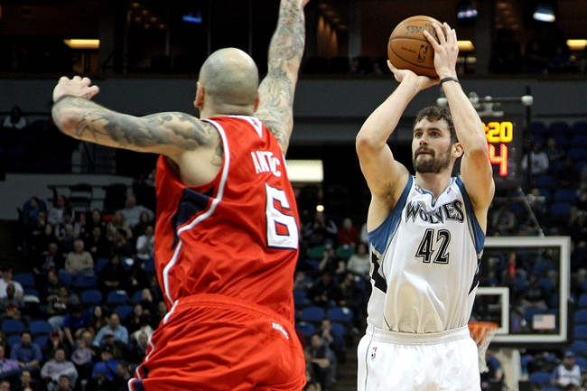 Mar 26, 2014; Minneapolis, MN, USA; Minnesota Timberwolves forward Kevin Love (42) shoots over Atlanta Hawks center Pero Antic (6) during the third quarter at Target Center. The Timberwolves defeated the Hawks 107-83. Mandatory Credit: Brace Hemmelgarn-USA TODAY Sports