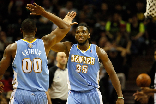 Mar 26, 2014; San Antonio, TX, USA; Denver Nuggets forward Kenneth Faried (35) celebrates a score with Denver Nuggets forward Darrell Arthur (00) during the second half at AT&T Center. Mandatory Credit: Soobum Im-USA TODAY Sports