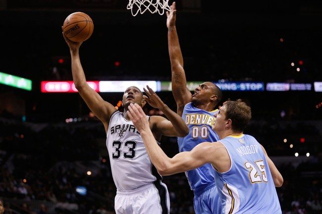 Mar 26, 2014; San Antonio, TX, USA; San Antonio Spurs forward Boris Diaw (33) shoots as Denver Nuggets forward Darrell Arthur (0) and center Timofey Mozgov (25) defend during the second half at AT&T Center. The Spurs won 108-103. Mandatory Credit: Soobum Im-USA TODAY Sports