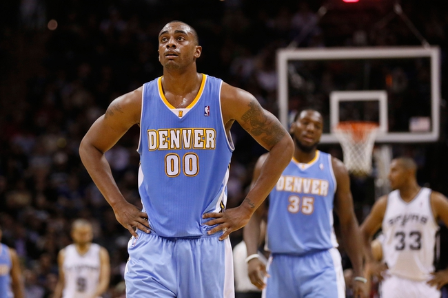 Mar 26, 2014; San Antonio, TX, USA; Denver Nuggets forward Darrell Arthur (0) reacts during the second half against the San Antonio Spurs at AT&T Center. The Spurs won 108-103. Mandatory Credit: Soobum Im-USA TODAY Sports